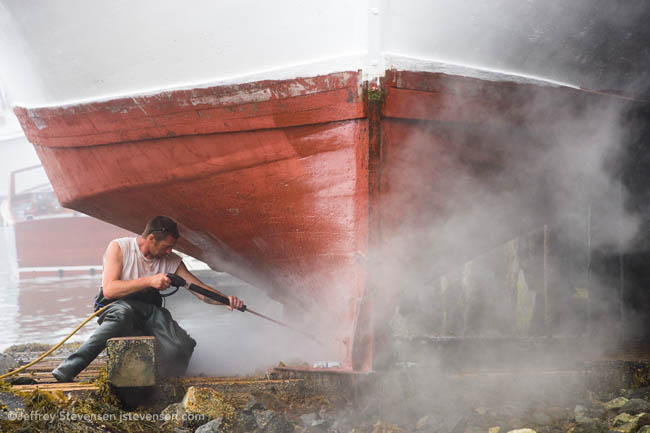 Cleaning the hull of the Ella Christine, Port Clyde Harbor, Maine